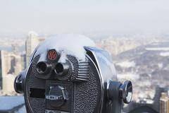 USA, New York City, Coin operated binoculars covered with snow, Central Park in Stock Photos