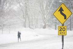 USA, New York City, speed limit and warning sign by snowy road - stock photo