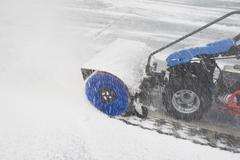 USA, New York City, machine removing snow Stock Photos