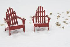 USA, New York City, two adirondack chairs in snow Stock Photos