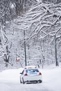 USA, New York City, police car on snowy road - stock photo