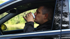 Man with coffee in car episode 1 Stock Footage