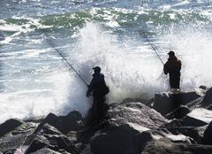 Stock Photo of USA, New York, Long Island, Montaurk, Men fishing in sea