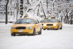 USA, New York City, yellow cabs on snowy street Stock Photos