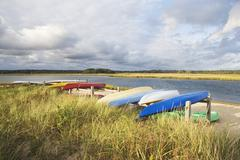 USA, New York, Long Island, East Hampton, Boats lying upside down on jetty - stock photo