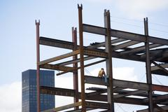 USA, New York City, Construction worker sitting on unfinished structure Stock Photos