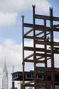 Stock Photo of USA, New York City, Construction worker sitting on unfinished structure