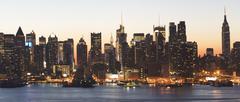 Stock Photo of USA, New York City, Manhattan skyline at dusk