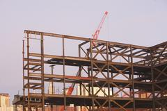 Stock Photo of USA, New York City, Crane with unfinished built structure