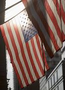 USA, New York City, Backlit American flags Stock Photos