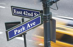 Stock Photo of USA, New York City, Manhattan, Road direction sign at crossroads of 42nd Street