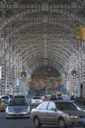 USA, New York City, Traffic passing under bridge - stock photo