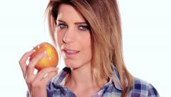 Healthy young woman eating an apple Stock Footage