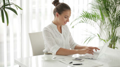 Attractive woman using laptop and smiling Stock Footage