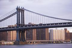 USA, New York State, New York City, bridge with city in background Stock Photos