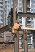USA, New York, Long Island, New York City, Male workers on construction site Stock Photos