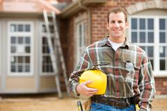 Construction: contractor in front of new home Stock Photos