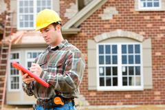 Construction: home inspector checking house Stock Photos