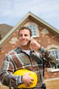 Construction: contractor on the phone Stock Photos