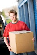 Storage: man taking box to storage Stock Photos