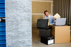 storage: saving money by working in storage unit - stock photo