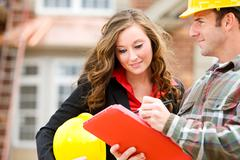 Construction: focus on female manager Stock Photos