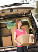 storage: getting box out of truck - stock photo