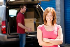 Stock Photo of storage: woman with truck full of boxes
