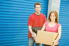 Storage: couple carrying boxes to unit Stock Photos