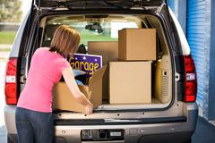 Stock Photo of storage: woman packing away garage sale leftovers