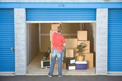 Storage: closing the storage unit door Stock Photos