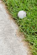 golf ball near the cart path - stock photo
