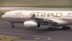 Etihad A330 airplane on taxiway - stock footage