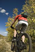 Person riding mountain bike, Utah, United States - stock photo