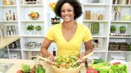Stock Video Footage of African American Girl Kitchen Mixing Fresh Salad Vegetables