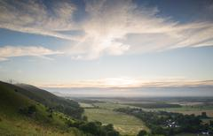 view across english countryside landscape during late summer evening with dra - stock photo