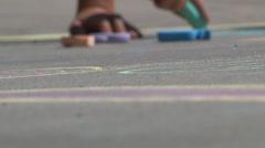 Child draws with sidewalk chalk. Stock Footage