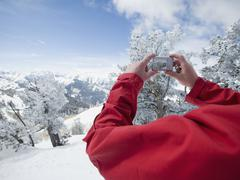Man taking photograph, Wasatch Mountains, Utah, United States Stock Photos