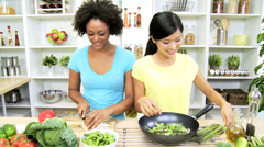 Asian Chinese African American Girls Kitchen Fresh Vegetable Stir Fry Stock Footage