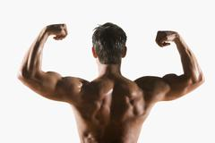 Male body builder flexing and posing Stock Photos