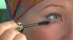 Close-up woman applying mascara rimmel beauty salon blonde girl lady mirror Stock Footage