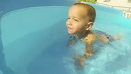 Little Child Playing in the Swimming Pool Stock Footage