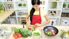 Ethnic Girl Home Kitchen Fresh Stir Fry Vegetables - stock footage