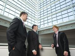 Businessmen socializing in convention center atrium Stock Photos