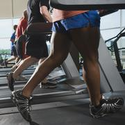 Men running on treadmills - stock photo