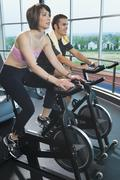 Stock Photo of Man and woman on stationary bikes