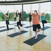 Stock Photo of Yoga class in mountain pose