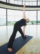 Woman in triangle pose - stock photo