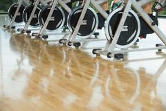 Exercise bikes in a row - stock photo