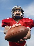 Stock Photo of Quarterback holding football